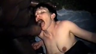 Short-haired brunette wife riding a big black cock in the outdoors